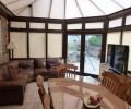 wood and glass conservatory extension in Woodlands